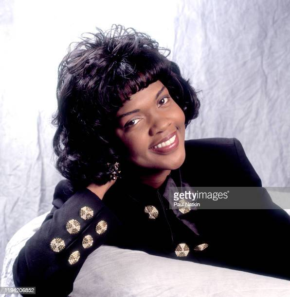 Portrait of American Gospel singer CeCe Winans as she poses backstage at the Aire Crown Theater Chicago Illinois February 12 1995