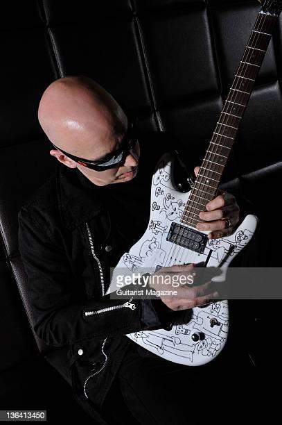 Portrait of American guitar virtuoso Joe Satriani posing with an ibanez JS2400 signature guitar taken on March 23 2007