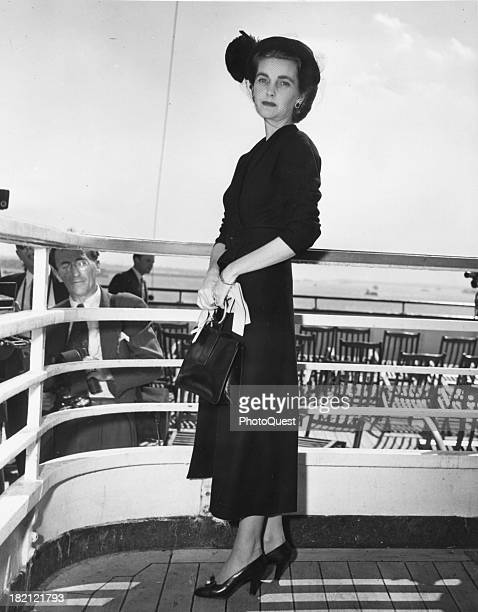 Portrait of American heiress and philanthropist Barbara Woolworth Hutton as she poses on the deck of the Cunard White Star Liner 'Queen Elizabeth' en...