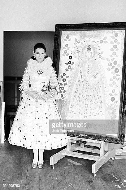 Portrait of American heiress and socialite Gloria Vanderbilt as she poses with one of her paintings, New York, New York, June 1968. Her dress, by...