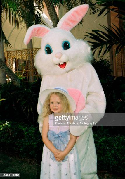 Portrait of American heiress Tiffany Trump as she poses with the Easter bunny at an event on the MaraLago estate Palm Beach Florida March 30 1997