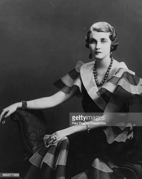 Portrait of American heiress to the Woolworth estate Barbara Hutton pictured sitting on a chair in 1941