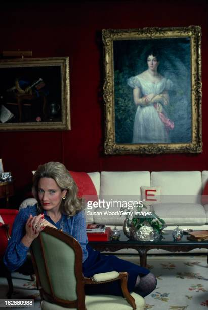 Portrait of American heiresses Charlotte M. Ford as she leans over the back of a chair, May 1983.