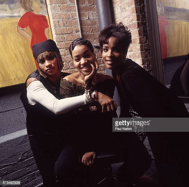 Portrait of American hip hop group Salt 'N' Pepa posed backstage at an unidentified nightclub Chicago Illinois October 3 1993 Pictured are from left...