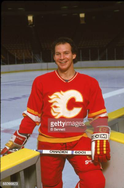 Portrait of American hockey player Joe Mullen of the Calgary Flames as he stands next to the boards December 1987