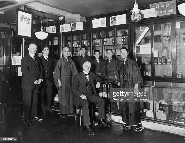 A portrait of American inventor and industrialist George Eastman founder of the Eastman Kodak Company posing with the staff of a Japanese photography...