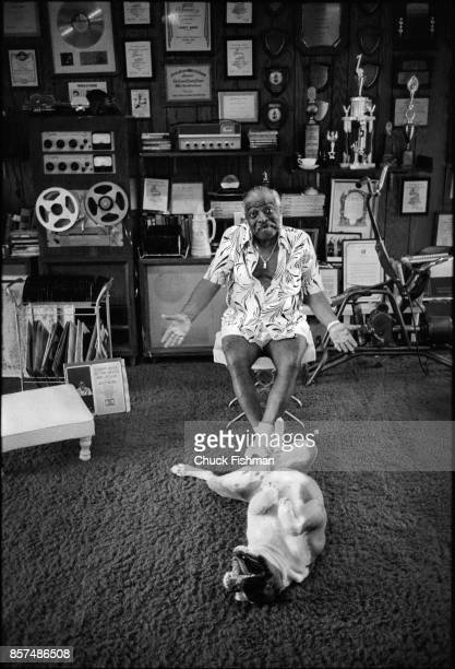 Portrait of American Jazz and Swing musician Count Basie and his bulldog Graf in his home Freeport Bahamas March 1979 In the room are a variety of...