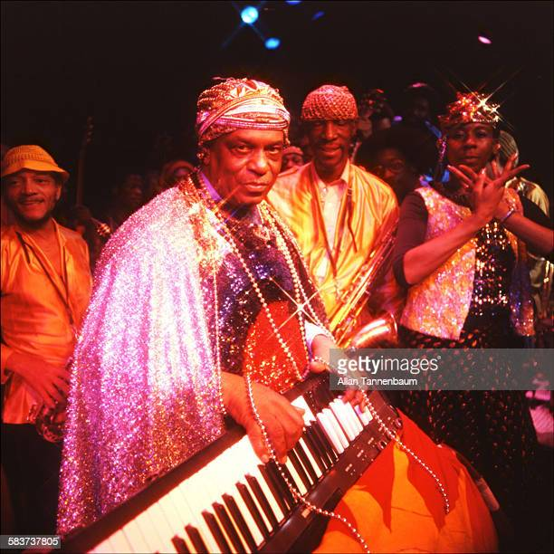 Portrait of American Jazz musician and bandleader Sun Ra and members of his Arkestra mid to late twentieth century