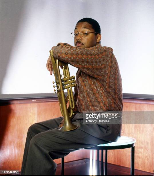 Portrait of American Jazz musician and composer Wynton Marsalis as he poses with his trumpet 1992