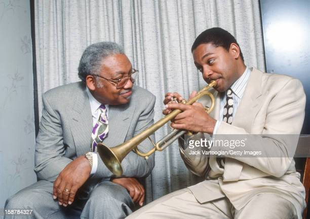 Portrait of American jazz musician Ellis Marsalis Jr and his son fellow musician Wynton Marsalis backstage after a rare performance as a duo at The...