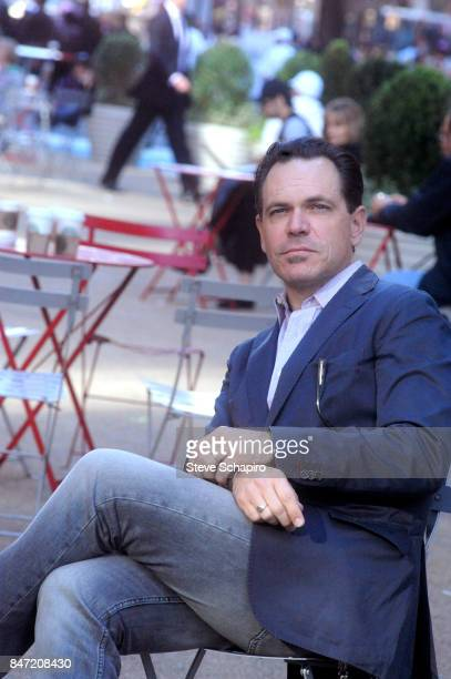 Portrait of American Jazz musician Kurt Elling as he sits outdoors in a plaza New York June 28 2009
