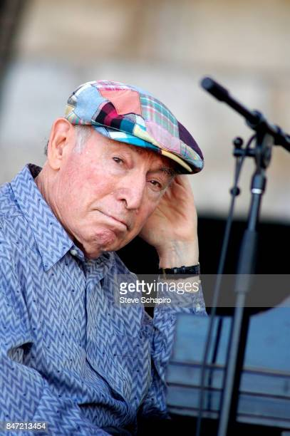 Portrait of American Jazz producer promotor and musician George Wein as he sits at a piano onstage during the Newport Jazz Festival Chicago Illinois...