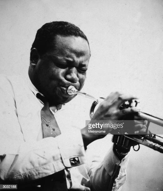 Portrait of American jazz trumpeter and bandleader Clifford Brown playing the trumpet 1940s