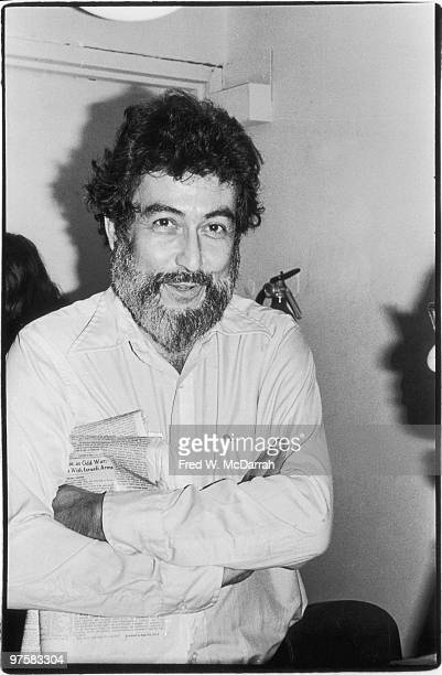 Portrait of American journalist and music critic Nat Hentoff as he stands with his arms folded at an office party for the Village Voice newspaper New...