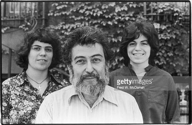 Portrait of American journalist and music critic Nat Hentoff as he poses with his daughters Miranda and Jessica New York New York May 31 1977
