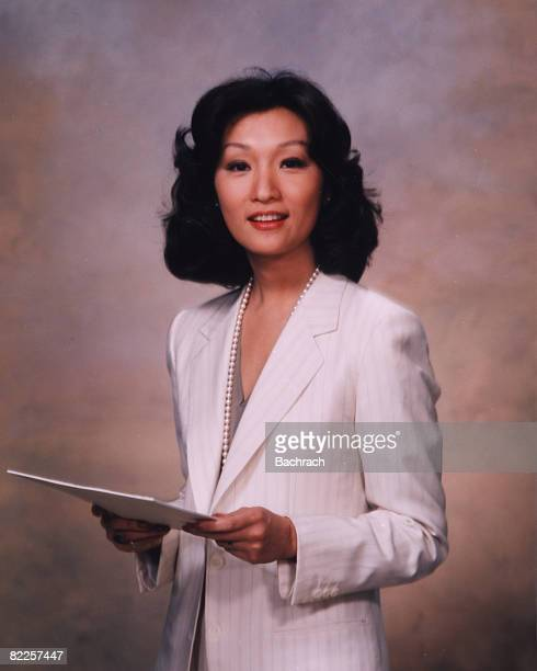 Portrait of American journalist and NBC news correspondent Connie Chung holding a document New York 1983
