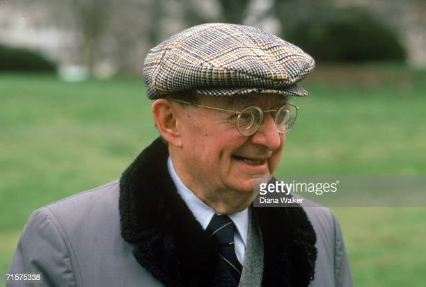 Portrait of American journalist IF Stone as he stands outdoors dressed in a furcollared coat and tweed cap March 1983