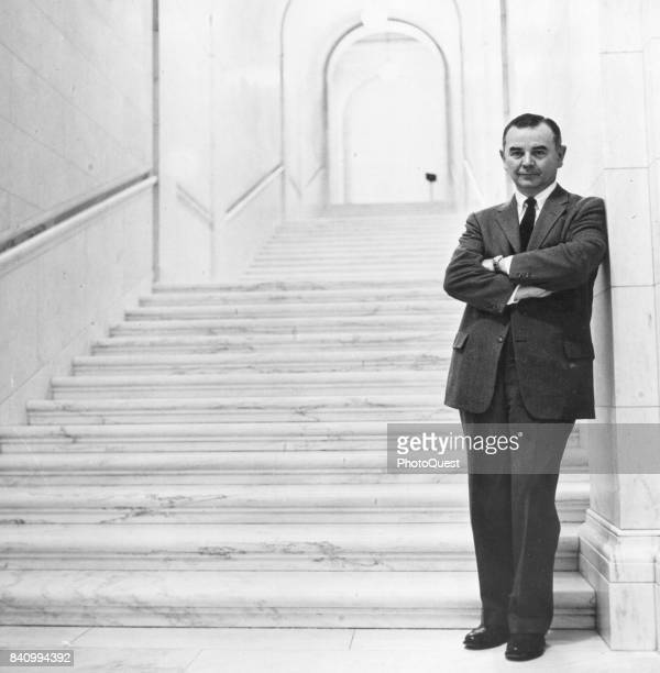 Portrait of American jurist Associate Justice of the US Supreme Court William J Brennan Jr as he poses at the foot of a marble staircase, Washington...