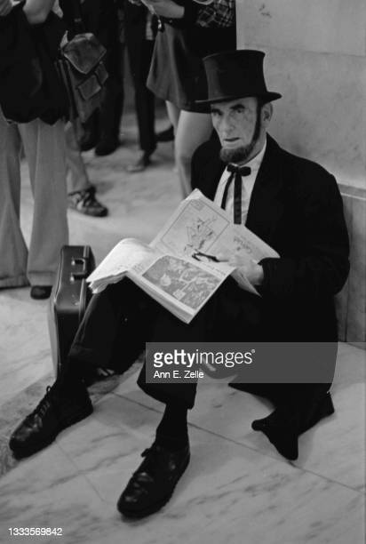 Portrait of American lawyer Arthur L 'Abe' Johnson as he sits, an open newspaper in his hands, on the floor of the Russell Senate Office Building,...