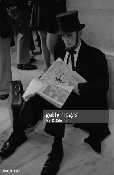 Portrait of American lawyer Arthur L 'Abe' Johnson as he sits, reading a newspaper, on the floor of the Russell Senate Office Building, Washington...