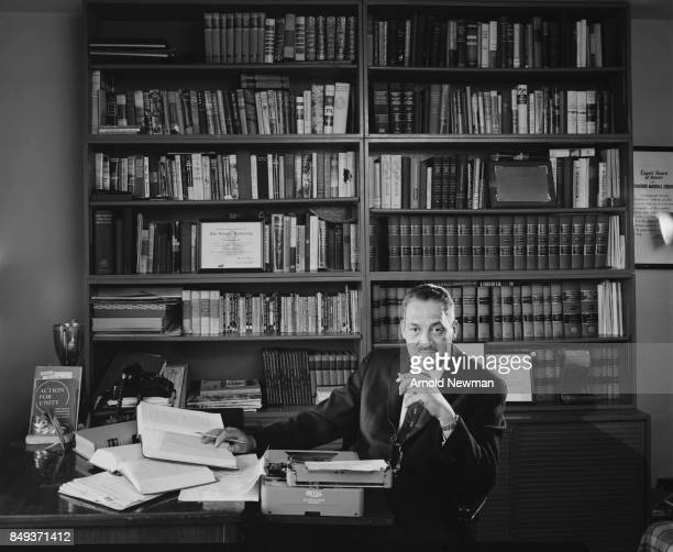 Portrait of American lawyer Thurgood Marshall as he sits at a desk in his Harlem office New York New York February 1 1960