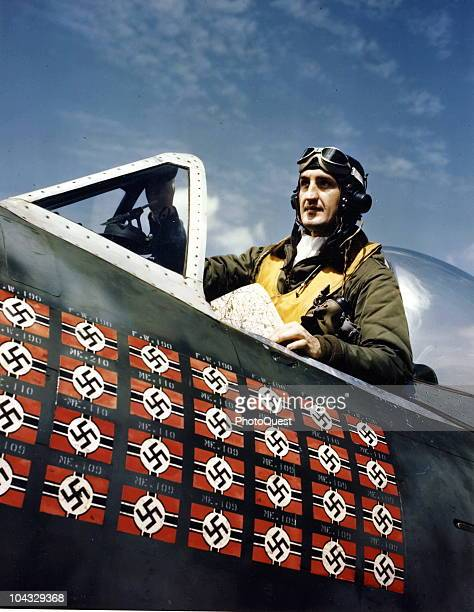 Portrait of American Lieutenant Colonel Francis S Gabreski as he sits in cockpit of his Republic P47 Thunderbolt fighter plane at an unspecified base...