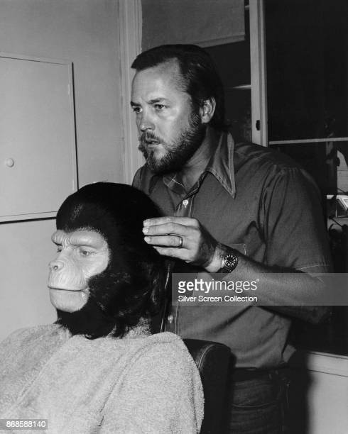 Portrait of American makeup artist Fred Blau works on EnglishAmerican actor Roddy McDowall to transform him into character backstage for an episode...