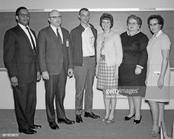 Portrait of American mathematician Katherine Johnson and various unidentified colleagues as they pose at NASA Langley Research Center, Hampton,...