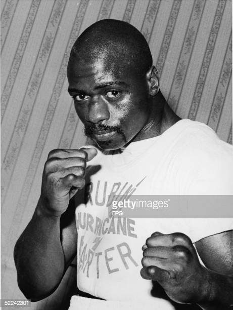 Portrait of American middleweight boxer Rubin 'Hurricane' Carter in a fighter's pose at Butcher's Arms his training headquarters for his upcoming...