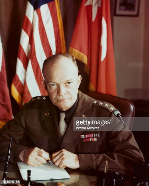 Portrait of American military commander General Dwight D Eisenhower as he sits at his desk December 1943