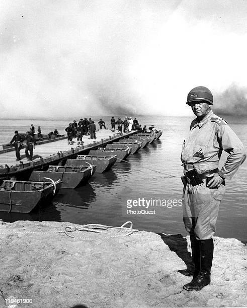 Portrait of American military commander General George S Patton commander of the 2nd Armored Division on the shore while behind him the 17th and 87th...