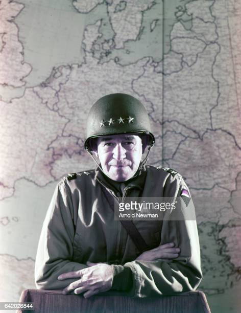 Portrait of American military commander General Omar Bradley in his helmet and fatigues as he poses in front of a map of Europe at the Pentagon...