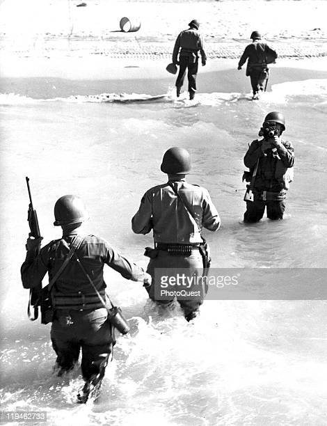 Portrait of American military commander Lieutenant General George S Patton wades ashore on a beach during the campaign to liberate Sicily Italy 1943...