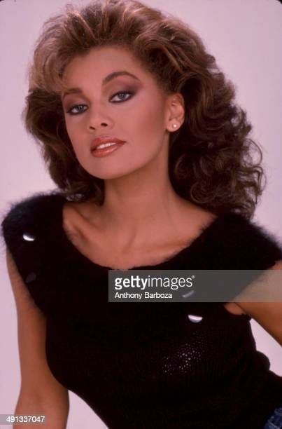 Portrait of American model actress and singer Vanessa L Williams as she poses against a pink background mid 1980s or early 1990s