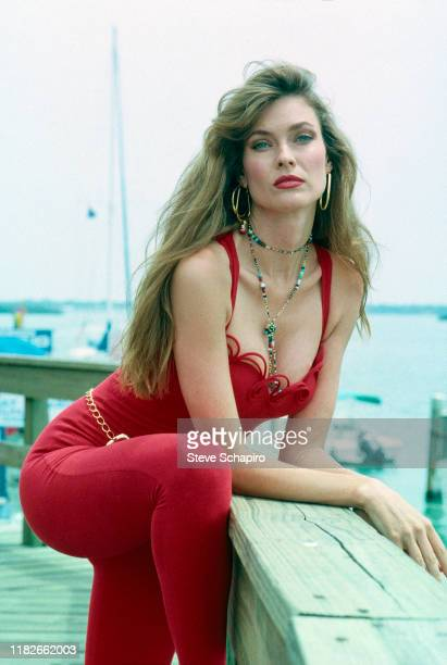 Portrait of American model and actress Carol Alt in a red outfit as she poses on the set of her television series 'Thunder in Paradise' Los Angeles...