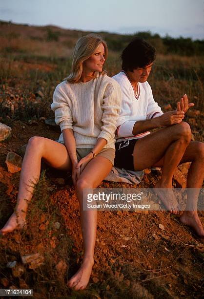 Portrait of American model and actress Cheryl Tiegs and her husband film director Stan Dragoti both barefoot ans dressed in shorts and sweaters as...