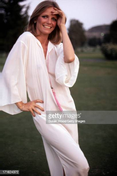Portrait of American model and actress Cheryl Tiegs as she poses outdoors dressed in a pink robe at La Costa Resort Spa Carlsbad California October...