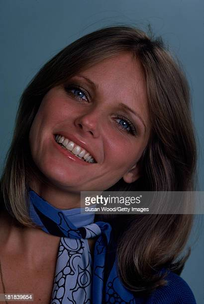 Portrait of American model and actress Cheryl Tiegs as she poses dressed in a blueprint neck scarf and a blue shortsleeved V neck sweater 1974 The...