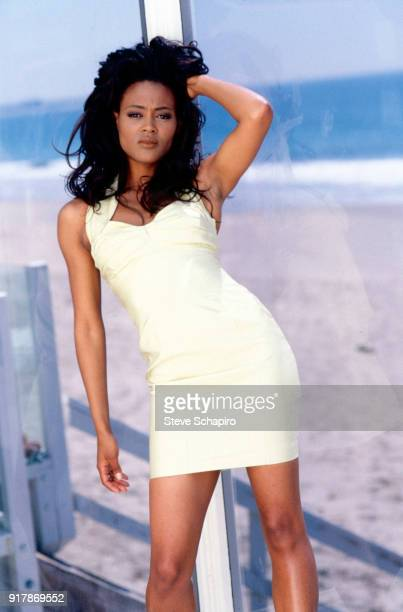 Portrait of American model and actress Robin Givens as she poses on a boardwalk near a beach Los Angeles California 1995