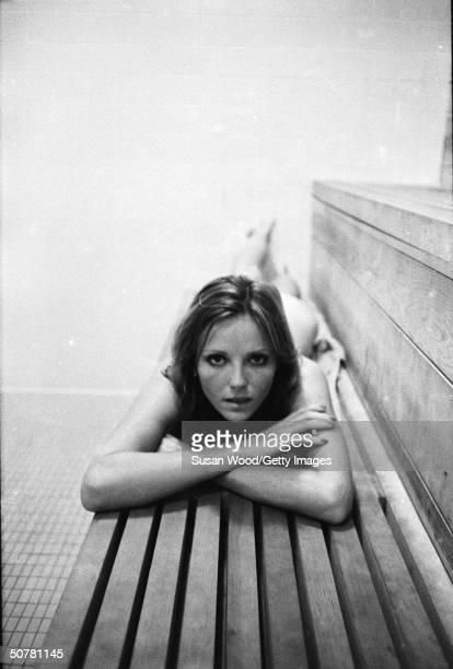 Portrait of American model Cheryl Tiegs laying nude inside a sauna 1970s
