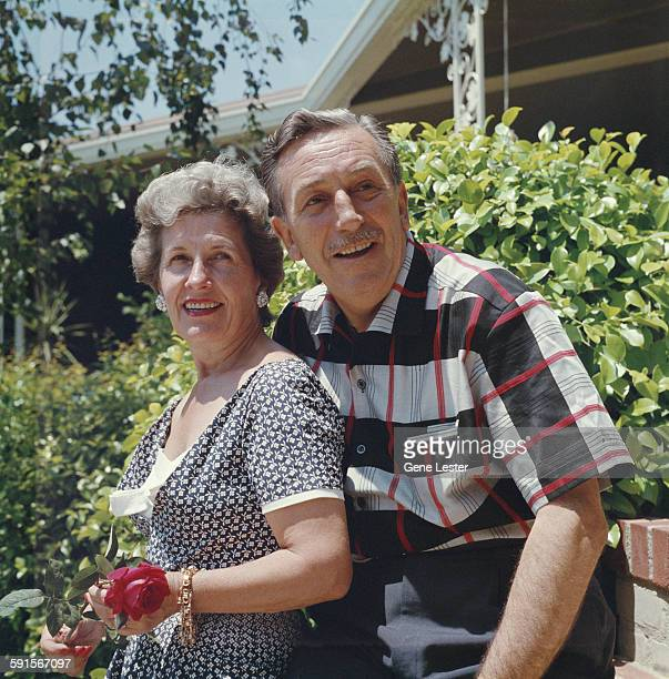Portrait of American movie producer artist and animator Walt Disney and his wife Lillian as they pose outdoors 1950s