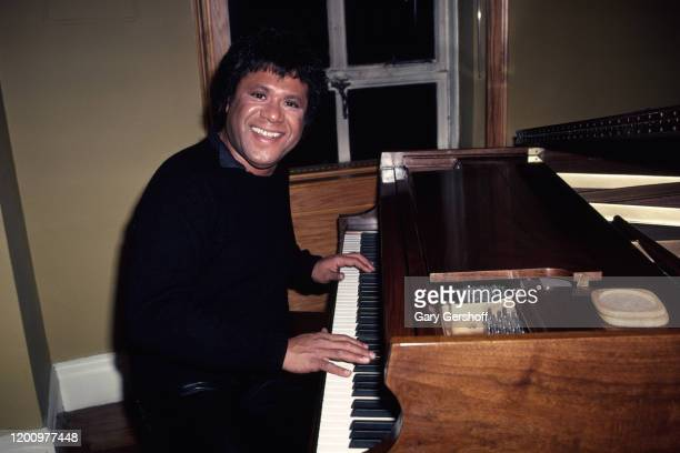 Portrait of American MTV VJ JJ Jackson as he smiles, seated at a piano, New York, New York, February 27, 1982. The photo was taken prior to Jackson...