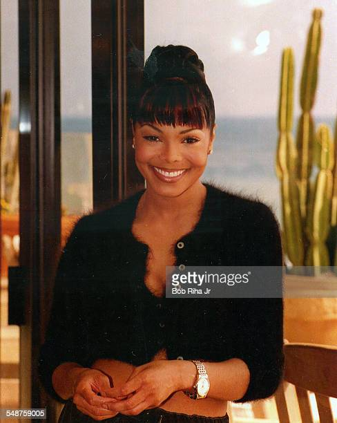 Portrait of American musician and actress Janet Jackson as she poses in her home during an interview on the television show 'Planet Groove' Malibu...