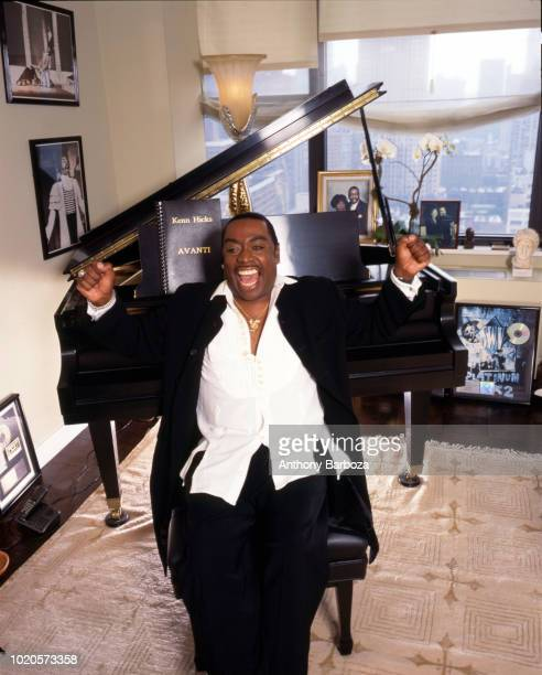 Portrait of American musician and vocal coach Kenn Hicks as he poses in front of a piano New York 1990s