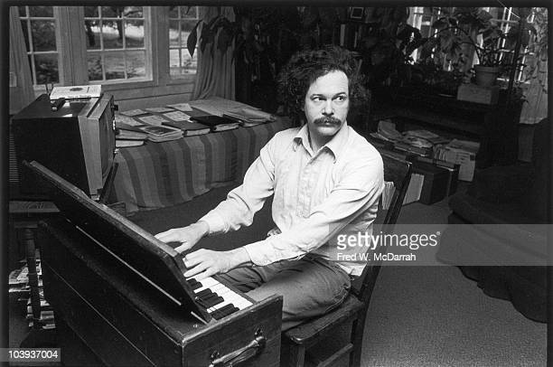 Portrait of American musician author and activist Ed Sanders as he plays a keyboard in his home in Woodstock New York May 29 1981
