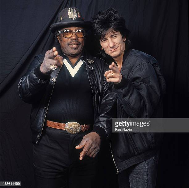 Portrait of American musician Bo Diddley and British musician Ron Wood backstage at the Riviera Theater before a performance Chicago Illinois...