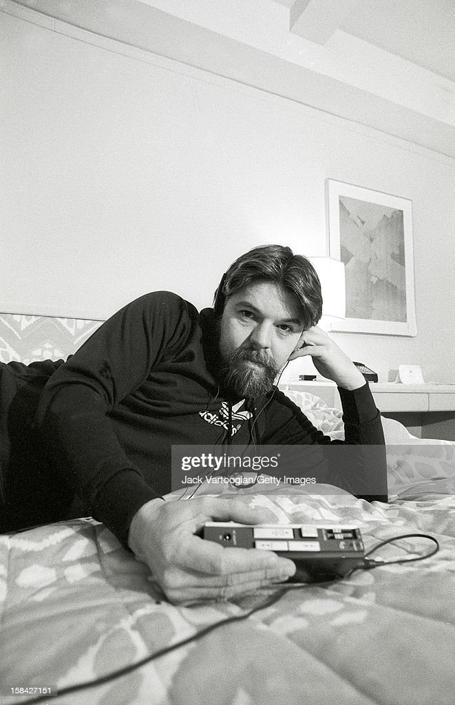 Portrait of American musician Bob Seger as he listen to a portable cassette player on the bed in his hotel room, New York, New York, December 13, 1982. The photo was taken for a People magazine feature.