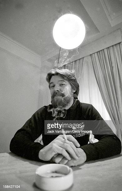 Portrait of American musician Bob Seger as he smokes a cigarette in his hotel room New York New York December 13 1982 The photo was taken for a...