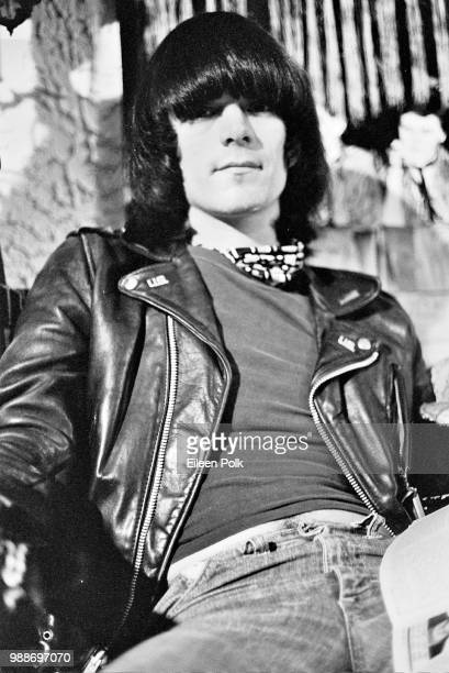 Portrait of American musician Dee Dee Ramone of the punk group Ramones as he sits in the clothing store Revenge New York New York 1977