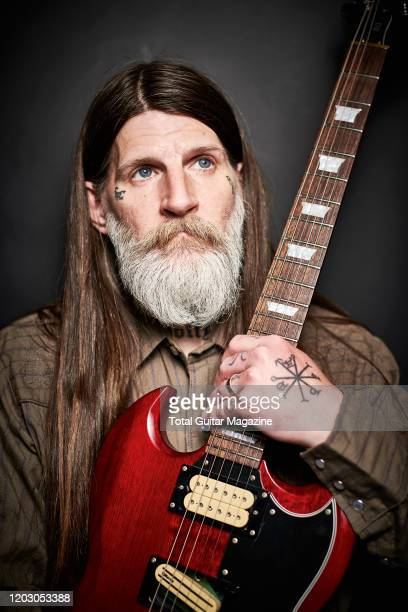 Portrait of American musician Dylan Carlson best known as a guitarist with rock group Earth photographed before a live performance at Rough Trade in...